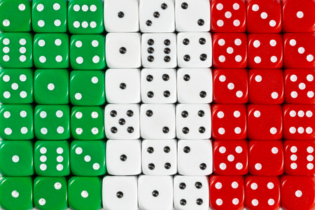 National flag of Italy in colorful background of dices