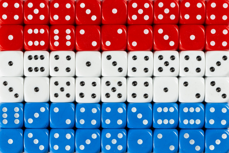 National flag of the Netherlands in colorful background of dices
