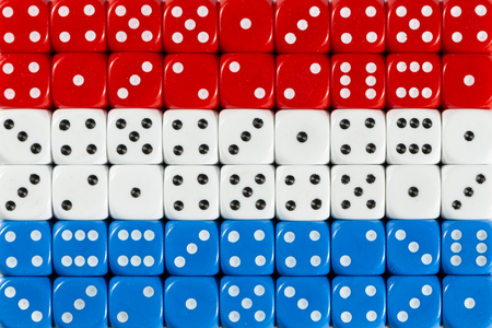 National flag of Luxembourg in colorful background of dices
