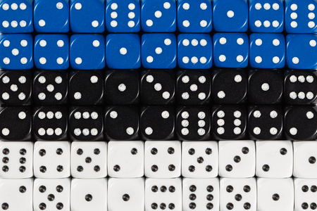 National flag of Estonia in colorful background of dices Stock Photo