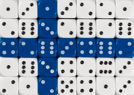 National flag of Finland in colorful background of dices Stock Photo