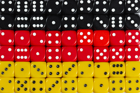 National flag of Germany in colorful background of dices