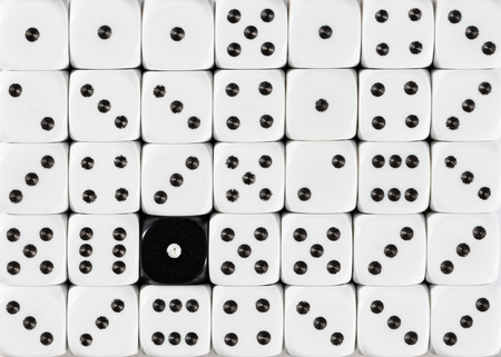 Pattern background of random ordered white dices with one black cube