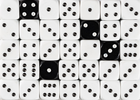 Pattern background of random ordered white dices with four black cubes