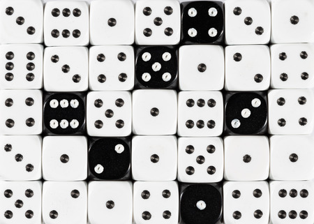 Pattern background of random ordered white dices with six black cubes
