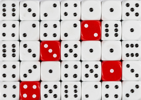 Pattern background of random ordered white dices with four red cubes
