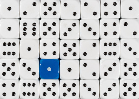 Pattern background of random ordered white dices with one blue cube