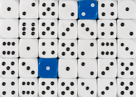 Pattern background of random ordered white dices with two blue cubes