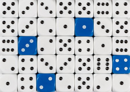 Pattern background of random ordered white dices with four blue cubes Stok Fotoğraf