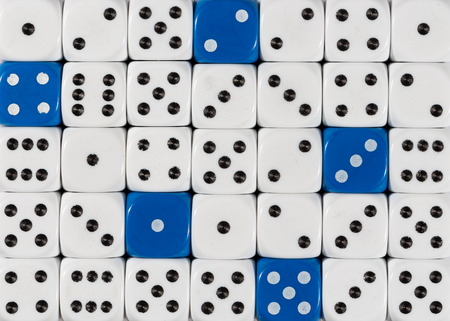 Pattern background of random ordered white dices with blue cubes
