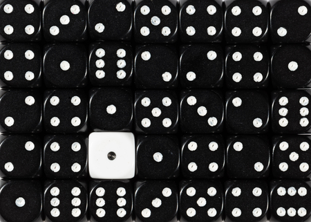 Pattern background of random ordered black dices with one white cube