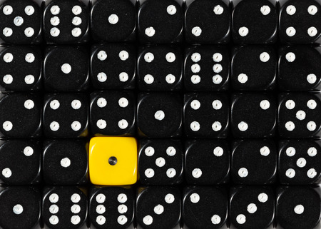 Pattern background of random ordered black dices with one yellow cube Stok Fotoğraf