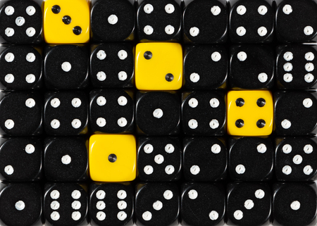 Pattern background of random ordered black dices with four yellow cubes Stok Fotoğraf