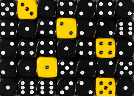 Pattern background of random ordered black dices with five yellow cubes
