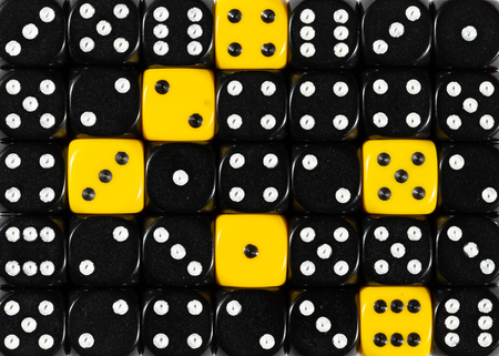 Pattern background of random ordered black dices with six yellow cubes