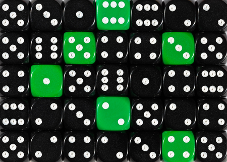 Pattern background of random ordered black dices with six green cubes Stok Fotoğraf