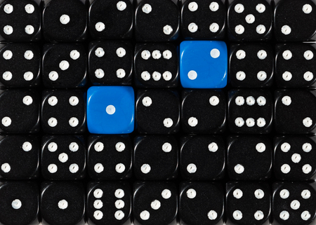 Pattern background of random ordered black dices with two blue cubes