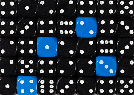 Pattern background of random ordered black dices with four blue cubes