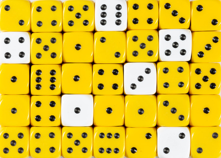 Pattern background of random ordered yellow dices with six white cubes