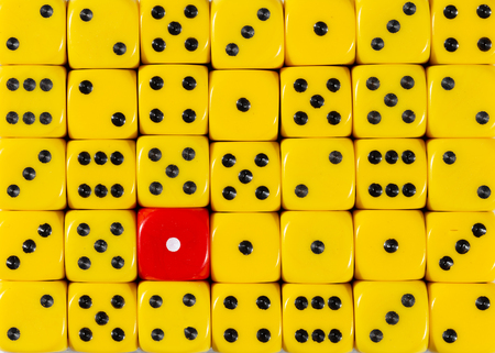Pattern background of random ordered yellow dices with one red cube Stok Fotoğraf