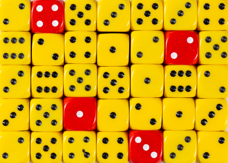 Pattern background of random ordered yellow dices with four red cubes
