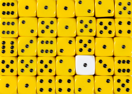 Pattern background of random ordered yellow dices with one white cube Stok Fotoğraf