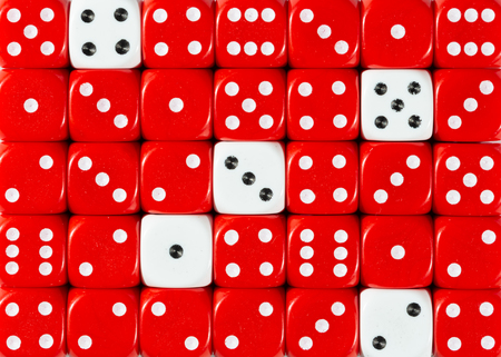 Pattern background of random ordered red dices with five white cubes