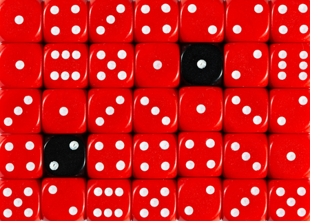 Pattern background of random ordered red dices with two black cubes