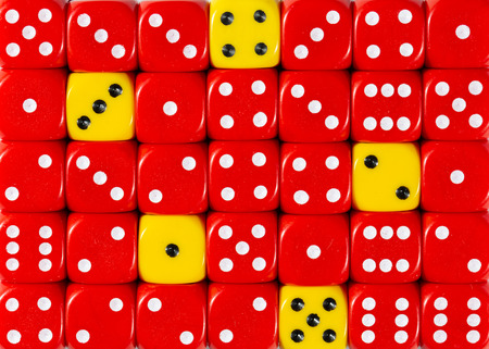 Pattern background of random ordered red dices with five yellow cubes Stok Fotoğraf