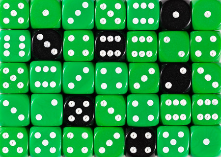 Pattern background of random ordered green dices with six black cubes