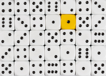 Pattern background of random ordered white dices with one yellow cube