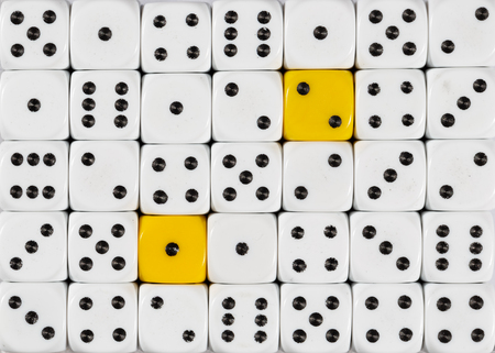 Pattern background of random ordered white dices with two yellow cubes