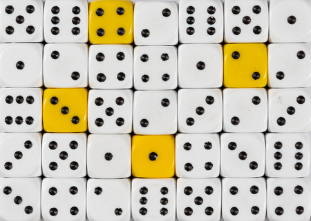Pattern background of random ordered white dices with four yellow cubes