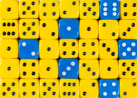 Pattern background of random ordered yellow dices with six blue cubes