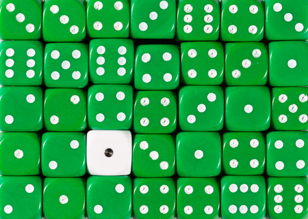 Pattern background of random ordered green dices with one white cube