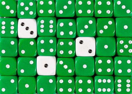 Pattern background of random ordered green dices with three white cubes