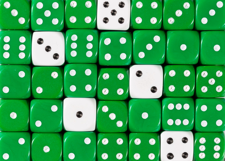 Pattern background of random ordered green dices with five white cubes