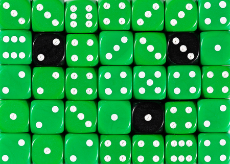 Pattern background of random ordered green dices with three black cubes