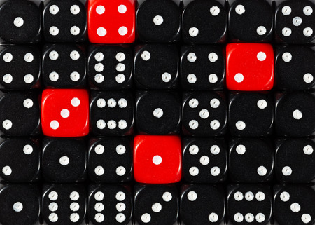 Pattern background of random ordered black dices with four red cubes