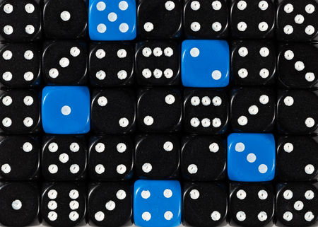 Pattern background of random ordered black dices with five blue cubes Stok Fotoğraf