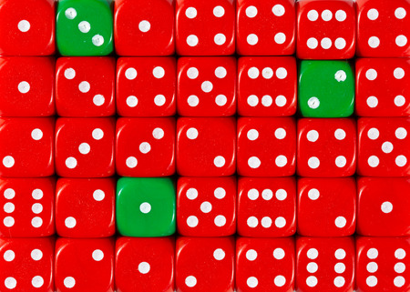 Pattern background of random ordered red dices with three green cubes