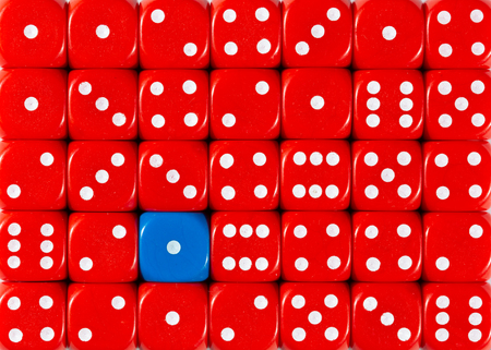 Pattern background of random ordered red dices with one blue cube Stok Fotoğraf - 121666539
