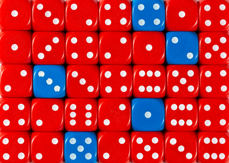 Pattern background of random ordered red dices with five blue cubes