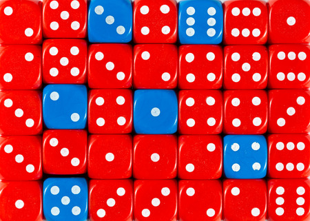 Pattern background of random ordered red dices with six blue cubes Foto de archivo