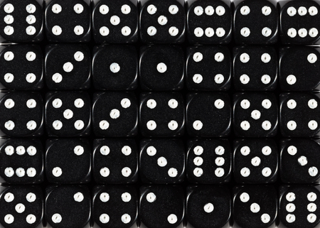 Pattern background of black dices, random ordered