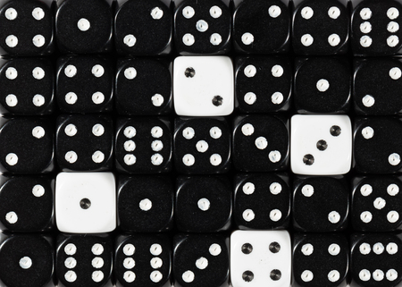 Pattern background of random ordered black dices with four white cubes