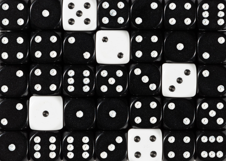 Pattern background of random ordered black dices with five white cubes