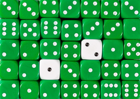 Pattern background of random ordered green dices with two white cubes Stok Fotoğraf - 121666566