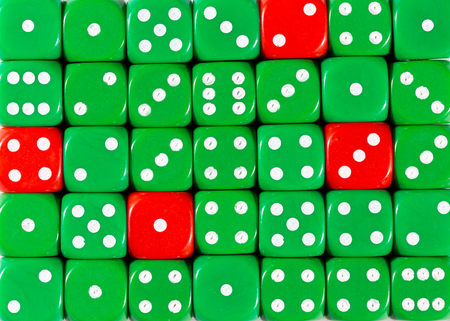 Pattern background of random ordered green dices with four red cubes