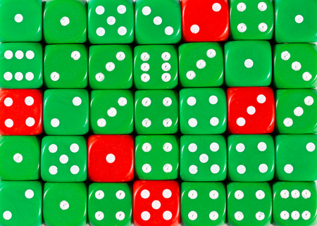Pattern background of random ordered green dices with five red cubes